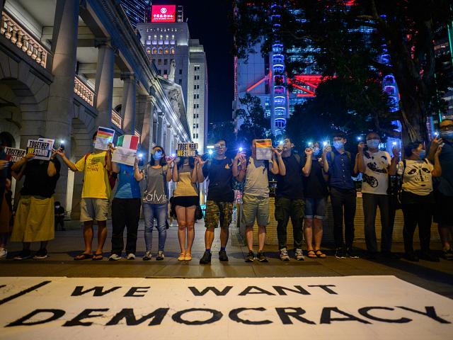 Hong Kong Protesters Form 28-Mile Human Chain